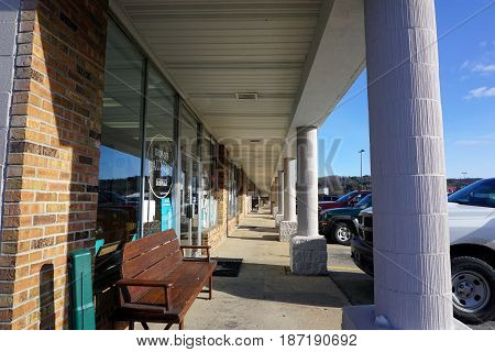 BAY VIEW, MICHIGAN / UNITED STATES - NOVEMBER 26, 2016: The covered walkway of a strip mall in Bay View, Michigan.