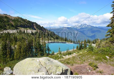 Middle of Whistler mountain in the summer where the water basin sits
