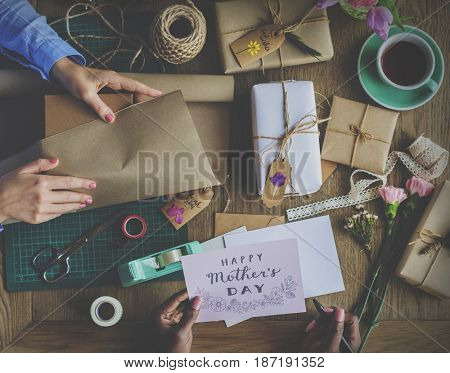 Hands Wrapping Present Box with Flower Decoration Handicraft