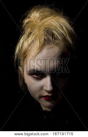 Young girl vampire on a black background