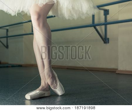 Ballerina in pointes and pack poses. Classical ballet. Prima ballerina. Shooting close-up.