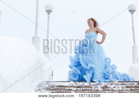 Woman In A Beautiful Blue Dress In A Winter