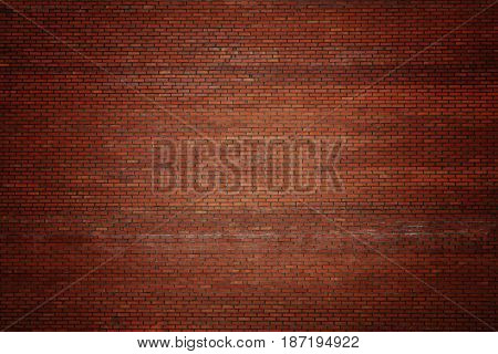 Dark old red vignetted brick stone wall background