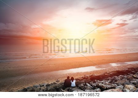 Future Together Concept. Landscape Of Couple Lover People Sitting Together On The Beach Looking Forw