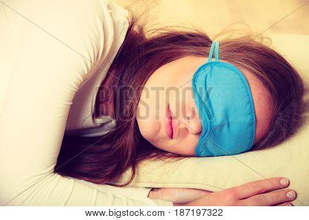 Brunette Woman Sleeping In Blue Eye Sleep Mask