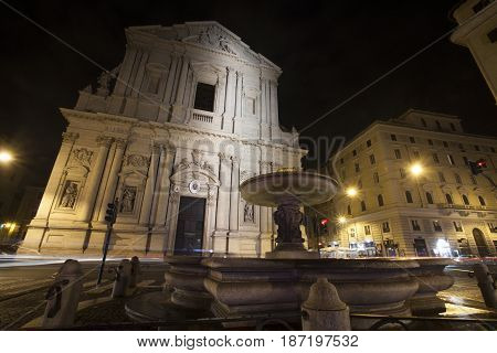 ROME, ITALY. JANUARY 07, 2015: Sant Andrea della Valle is a basilica church in Rome, Italy, in the rione of Sant Eustachio. Night. Lampposts, signs and bright car headlights.