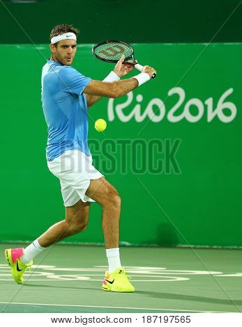 RIO DE JANEIRO, BRAZIL - AUGUST 12, 2016: Grand Slam Champion Juan Martin Del Porto of Argentina in action during men's singles quarterfinal of the Rio 2016 Olympic Games at the Olympic Tennis Centre