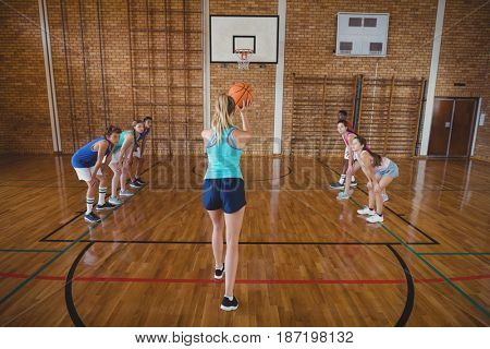 High school girl about to take a penalty shot while playing basketball in the court