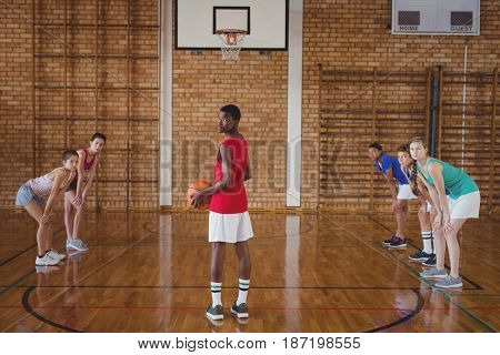 Portrait of high school boy about to take a penalty shot while playing basketball in the court