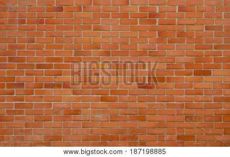 texture of stained old brown and red brick wall grungy rusty blocks of stonework colorful horizontal architecture. Can be use as background.