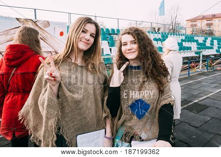 Gomel, Belarus - March 12, 2016: Two beautiful girls participating in the celebration Maslenitsa Shrovetide