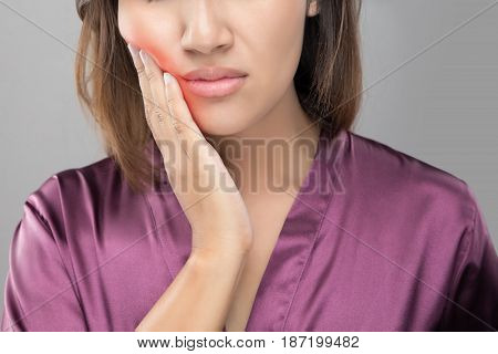 Closeup of beautiful young woman suffering from toothache Dental health and care People with teeth problem concept.