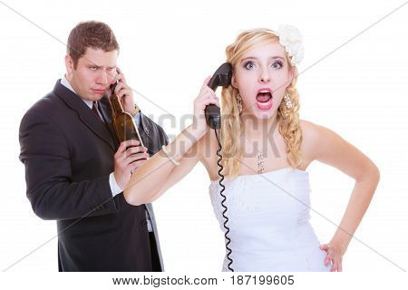 Addiction in relationship marriage problems and troubles concept. Bride having argument with drunk alcoholic groom she is calling for help