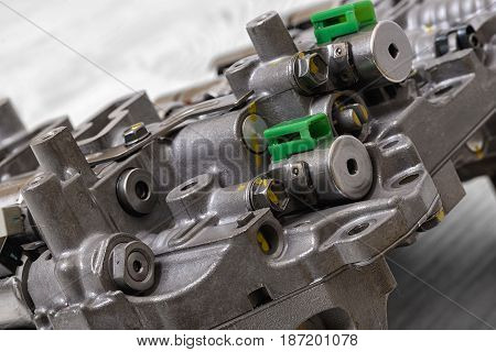 Mechanical part with metal components and hydraulic valves. Car repair. Engineering. Tools and spares.