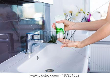 Woman Washing Up In The Morning