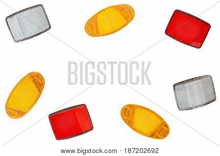 A scattering of bicycle light reflectors isolated on a white background