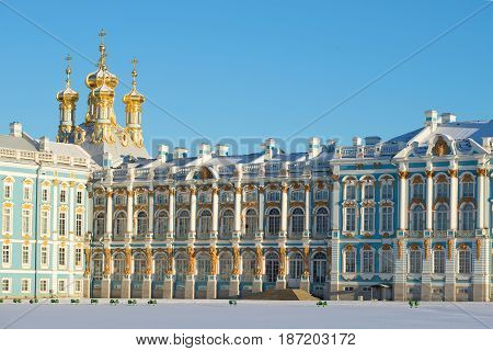 SAINT PETERSBURG, RUSSIA - FEBRUARY 06, 2017: Fragment of the facade of the Catherine Palace with the domes of the Resurrection Church on a sunny February day. Tsarskoye Selo, St. Petersburg