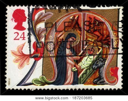 UNITED KINGDOM - CIRCA 1991: A stamp printed in Great Britain shows image of Mary and Jesus in stable, series Christmas 1991 - illuminated letters, circa 1991