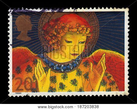 UNITED KINGDOM - CIRCA 1998: A stamp printed in Great Britain shows image of angel with hands raised in blessings, series Christmas 1998 - Angels, circa 1998