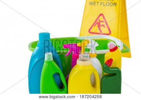 Cleaning bottles with sigh board against white background