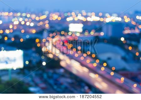 City highway road curved blurred bokeh light at twilight abstract background