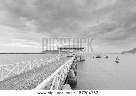 Black and White Wooden walking way over seacoast skyline nautral abstract background