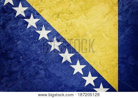Grunge Bosnia And Herzegovina Flag. Bosnian Flag With Grunge Texture.