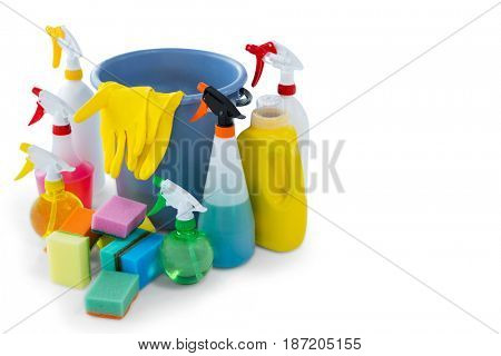 High angle view of bucket amidst cleaning products against white background