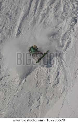 Snowboard freeride. Freerider falling in the mountain