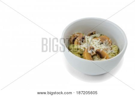 High angle view of prepared pasta served in bowl against white background