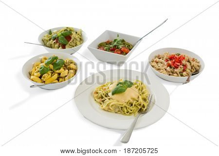 Close up of various pasta served in containers over white baclground