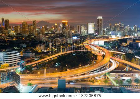 Blurred bokeh city downtown background and highway interchanged aerial view abstract background