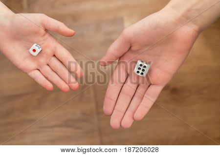 Dice in the palms of the hands