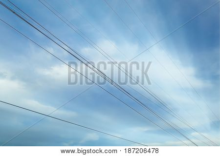 High voltage lines against with blue sky
