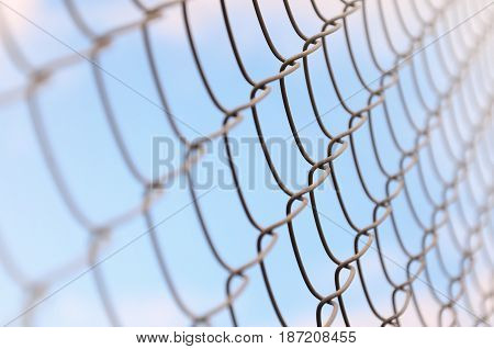 A Photograph Of A Metal Net Used As A Fence Of Private Possessions. Old Metal Grid In Perspective Wi