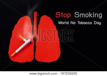 World No Tobacco Day Cigarette is burning with smoke on lung background.