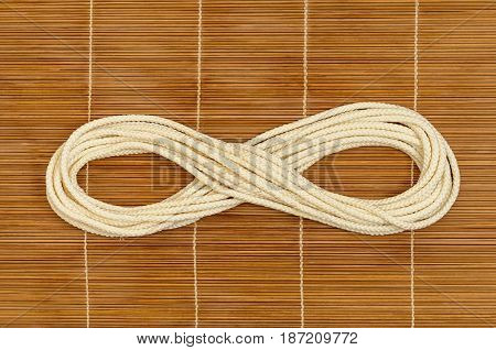 Rope is looped on a wooden background