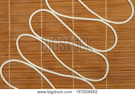 Zigzag from a rope on a wooden background