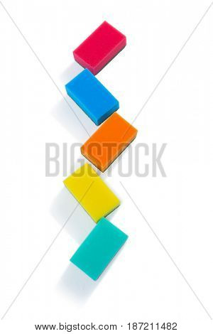 High angle view of colorful sponges against white background