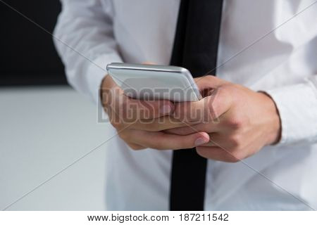 Close-up of androgynous man using his mobile phone
