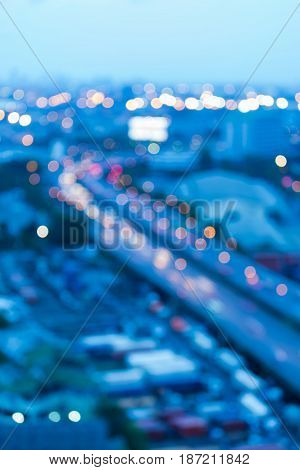 Night blurred bokeh light city road at twilight abstract background