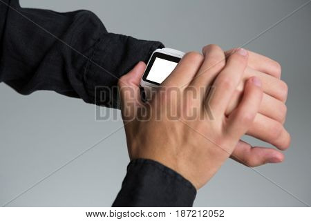 Close-up of androgynous man using smart watch