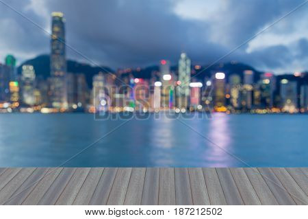 Opeing wooden floor Hong Kong city blurred bokeh light seafront abstract background