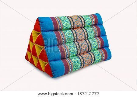 Thai triangular backrest pillow isolate on white background Thai triangular backrest is a backrest pillow, made from local fabric in the Northeast of Thailand. It was designed to be a triangle shaped like an ax. It is the cultural identity that grandparen