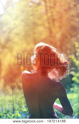 Beautiful woman standing with her back photographed in close-up
