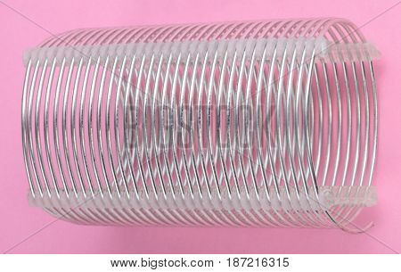 image of one radio coil on pink background