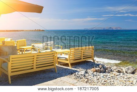 Tables with chairs in the traditional Greek tavern of Crete island, Greece.