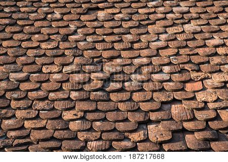 Ancient clay tiles background forming old roof surface