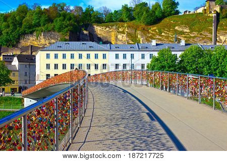 The bridge fence covered with locks in Salzburg. Salzburger Land, Austria