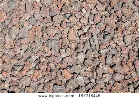 Pebbles of a reddish shade for paths
